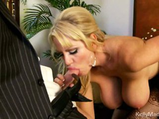 Cock junkie Kelly Madison gets a big huge one to suck a...