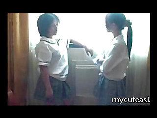 Two teen lesbian Asian girls fucking around