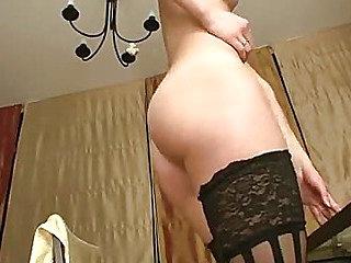 Tall brunette in stockings riding huge dildo