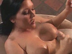 Big tits brunette babe giving nice handjob