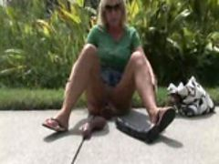 Pornstar toys her wet cunt in public