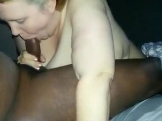 Blonde babe enjoys sucking big black cock of her horny ...