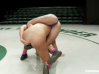Two buff athletes wrestle it out to see who gets to bru...