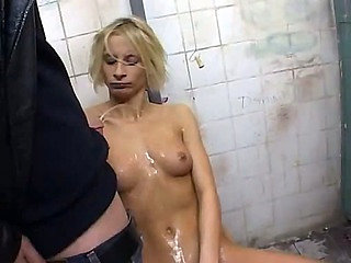They piss on her and gangbang her in bathroom