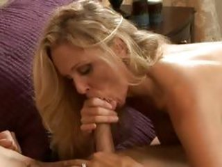Saucy Juila Ann treats her mouth to a juicy dick