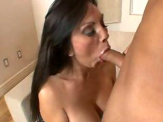 Bitchy hot Angela D Angelo fills her juicy mouth with a...
