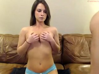 Pretty brunette with big tits works a huge dong on cam