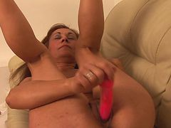 Horny mature gal grinding onto the couch