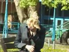 Blond pees in children park