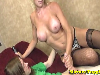Busty Milf Jerking Cock While In Stockings