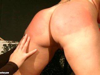 Kathia Nobili spanking a lusty babe on a chair